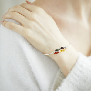 Silver cuff bracelet with baltic amber in different colors
