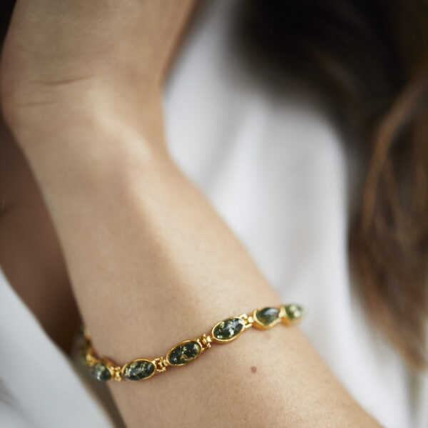 Gold plated bracelet with green amber