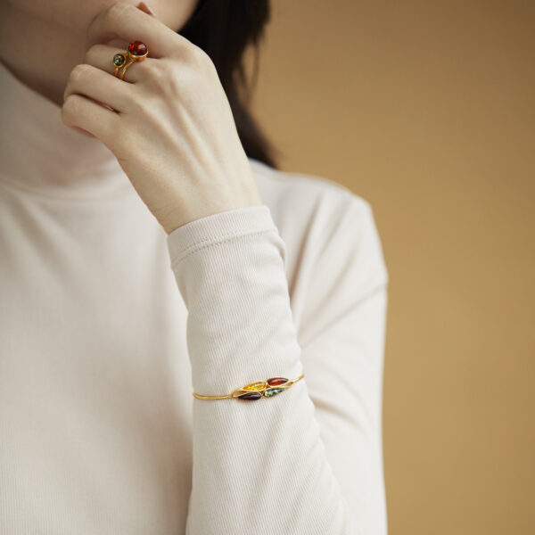 Gold plated cuff bracelet with multicolor amber