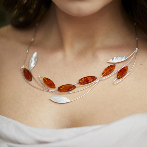 Unique and modern silver necklace with baltic amber