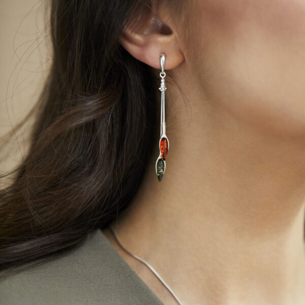 Extra long silver earrings with cognac and green amber